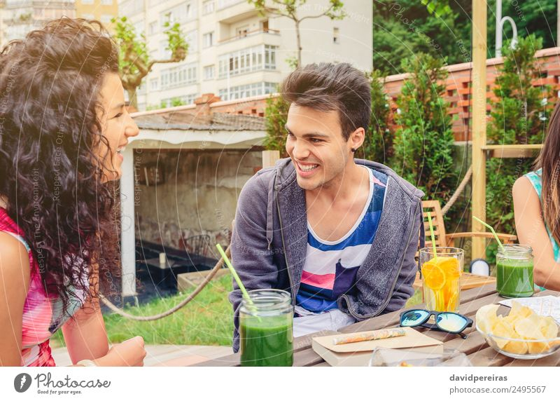 Young couple having fun in a summer day Vegetable Fruit Beverage Lifestyle Joy Happy Beautiful Leisure and hobbies Vacation & Travel Summer Garden Table To talk