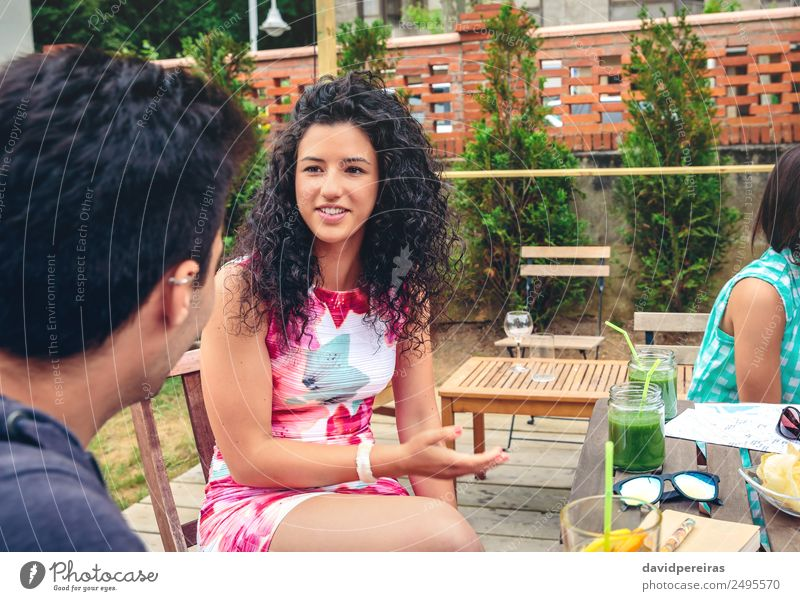 Young woman talking with friend in a summer day Vegetable Fruit Beverage Lifestyle Joy Happy Beautiful Leisure and hobbies Vacation & Travel Summer Garden Table