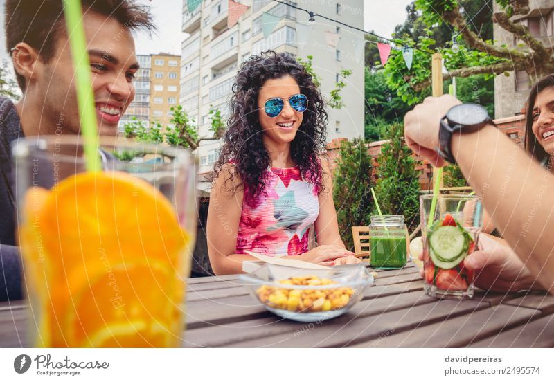 Young woman talking with friends in a summer day Vegetable Fruit Beverage Lifestyle Joy Happy Beautiful Leisure and hobbies Vacation & Travel Summer Garden