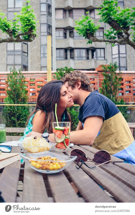 Young man whispering to woman sitting outdoors Vegetable Fruit Beverage Lifestyle Joy Happy Leisure and hobbies Summer Garden Table Human being Woman Adults Man