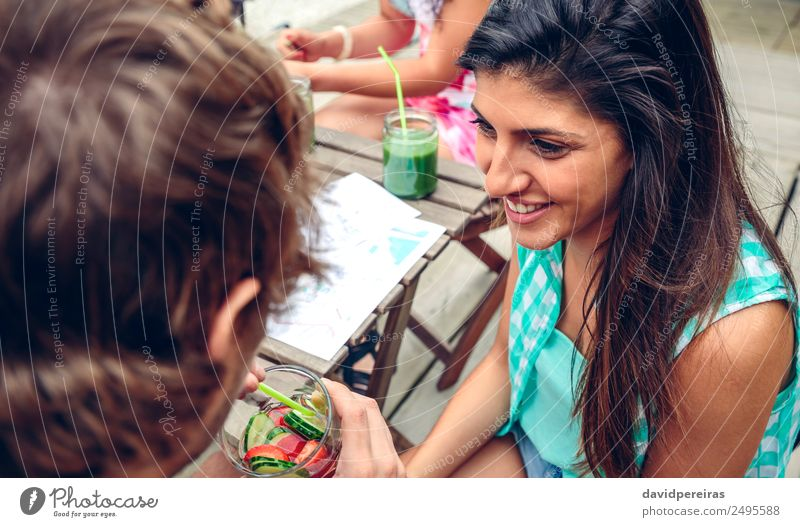Smiling woman looking man drinking infused water cocktail Vegetable Fruit Beverage Drinking Lifestyle Joy Happy Leisure and hobbies Summer Garden Table