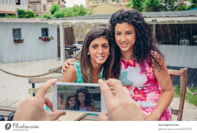 Man hands taking photo to two happy women outdoors Woman Human being Vacation & Travel Youth (Young adults) Summer Hand Adults Lifestyle Emotions Happy Couple