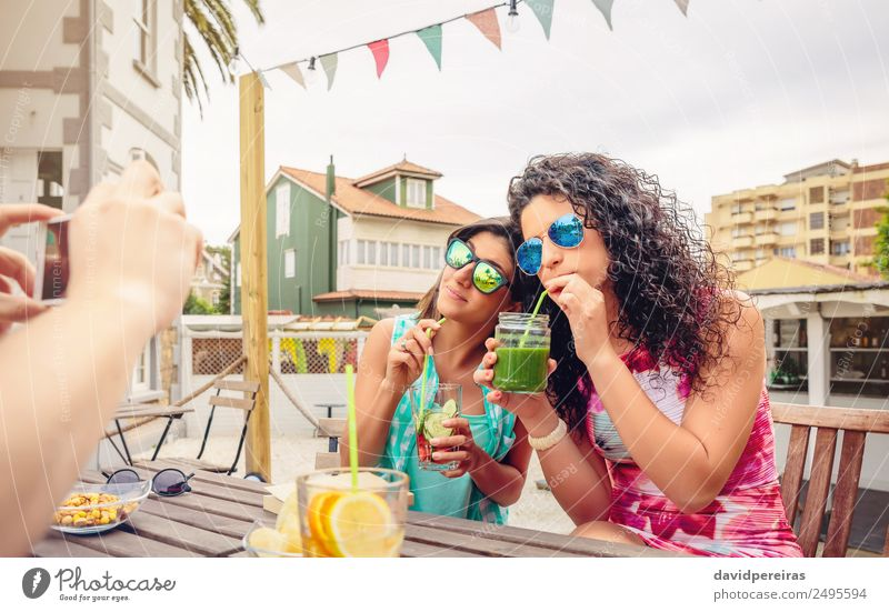 Young women couple drinking healthy drinks outdoors Vegetable Fruit Beverage Drinking Lifestyle Joy Happy Beautiful Leisure and hobbies Summer Garden