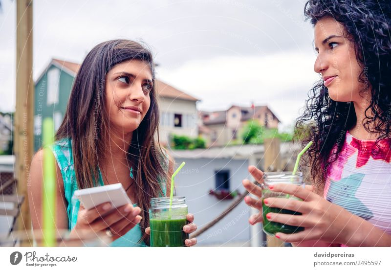 Two women looking at each other and holding green smoothies Woman Human being Nature Summer Green Adults Lifestyle Natural Emotions Happy Fruit Nutrition