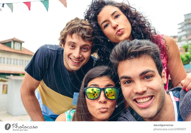 Young happy people looking at camera in a summer party outdoors Lifestyle Joy Happy Leisure and hobbies Vacation & Travel Summer Feasts & Celebrations Camera