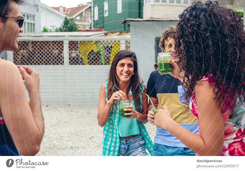 Happy people with beverages laughing in summer party Woman Human being Man Summer Beautiful Green Joy Adults Lifestyle Laughter Garden Feasts & Celebrations