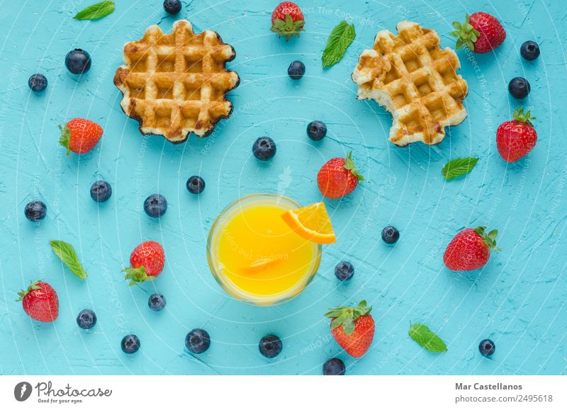 Waffles, red berries, mint leaves and orange juice Summer Blue Red Dish Lifestyle Above Fruit Nutrition Table Delicious Write Breakfast Dessert Cooking