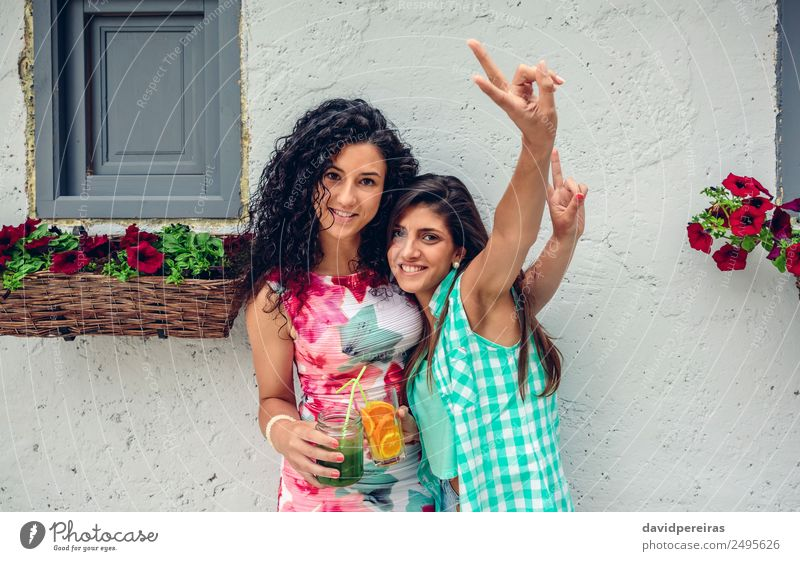 Two women with beverages doing victory sign Vegetable Fruit Beverage Juice Lifestyle Joy Happy Leisure and hobbies Summer Success Human being Woman Adults