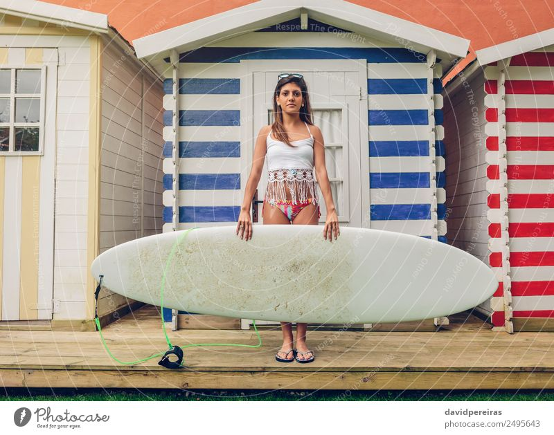 Young surfer woman with top and bikini holding surfboard Lifestyle Joy Happy Beautiful Leisure and hobbies Vacation & Travel Summer Beach Ocean Garden Sports