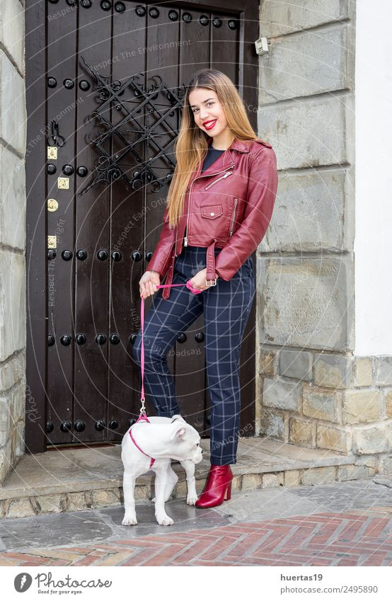 Beautiful blonde girl Human being Feminine Young woman Youth (Young adults) Woman Adults Friendship 18 - 30 years Fashion Blonde Animal Pet Dog Smiling Embrace