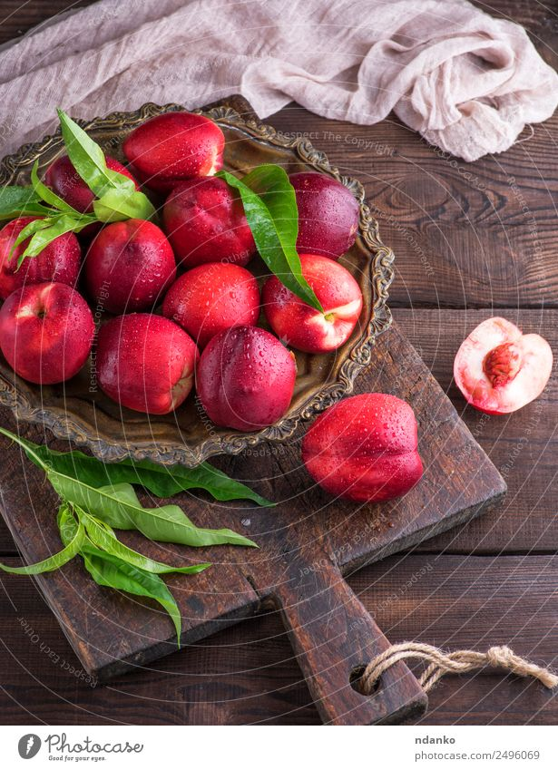red ripe peaches nectarine Fruit Dessert Nutrition Plate Table Wood Eating Fresh Above Juicy Brown Red Nectarine background food healthy sweet Raw Mature Peach