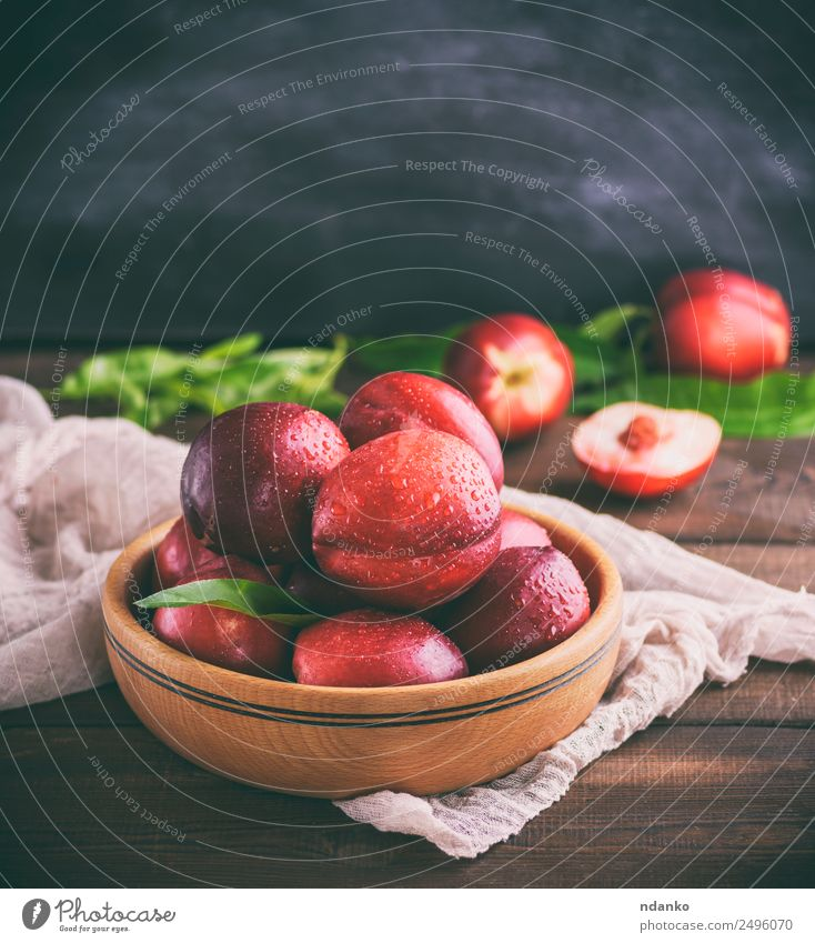 red ripe peaches nectarine Fruit Dessert Nutrition Plate Bowl Summer Table Leaf Wood Eating Fresh Juicy Brown Red Black Mature Peach Nectarine background food