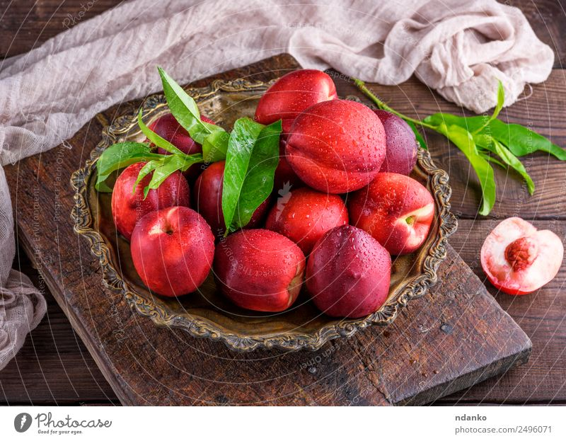 red ripe peaches Fruit Dessert Nutrition Plate Bowl Summer Table Leaf Wood Eating Fresh Above Juicy Brown Green Red Mature Peach Nectarine background food