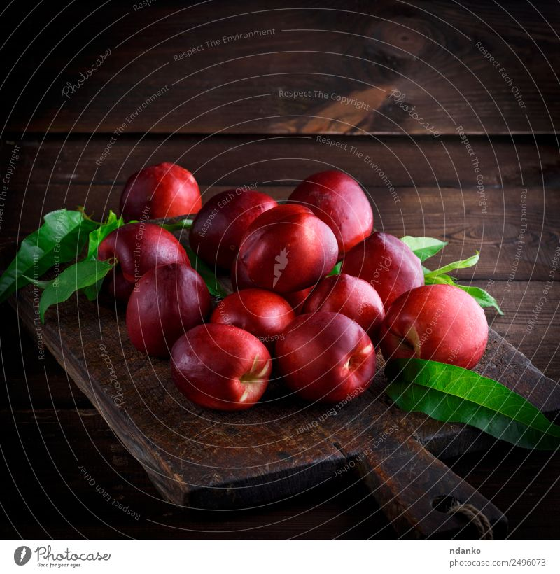 red ripe peaches nectarine Fruit Dessert Nutrition Summer Table Wood Fresh Juicy Brown Red Nectarine background food healthy sweet Raw Mature Peach whole Tasty