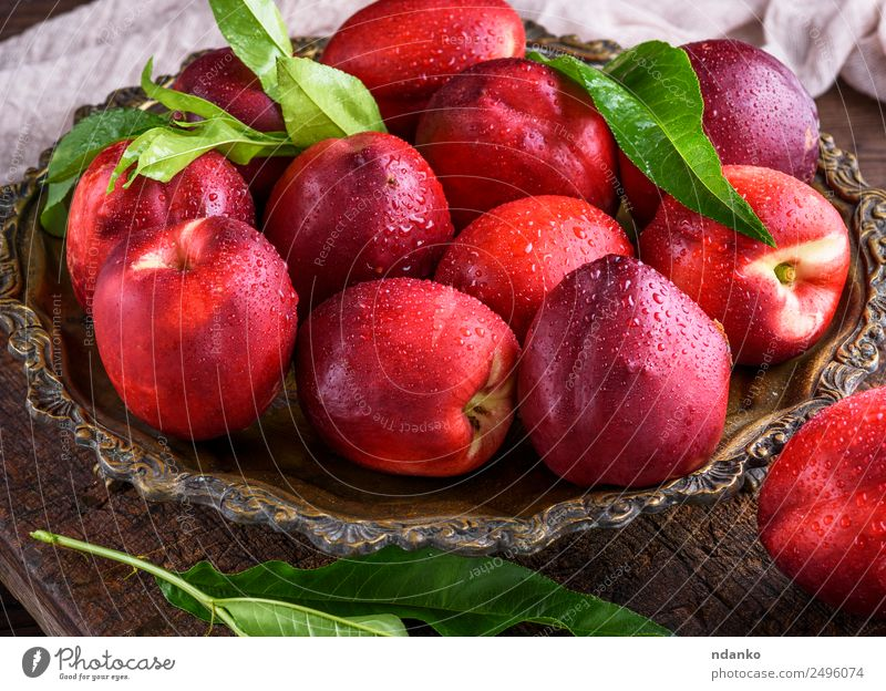 red ripe peaches nectarine Fruit Dessert Nutrition Plate Table Eating Fresh Juicy Brown Red Nectarine background food healthy sweet Raw Mature Peach whole Tasty