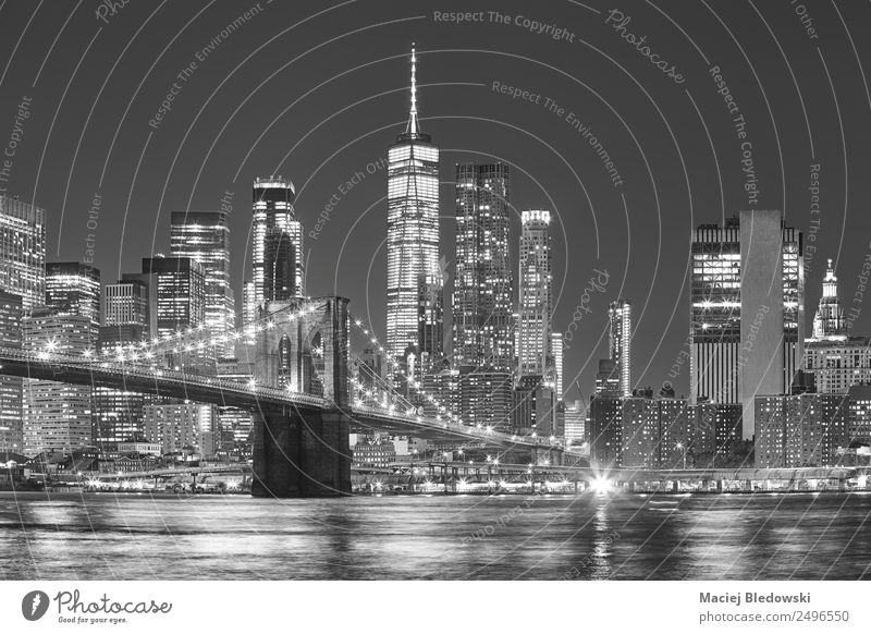Brooklyn Bridge and Manhattan skyline at night, New York. Office Sky River Town Skyline High-rise Bank building Building Architecture Tourist Attraction