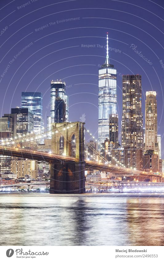 Brooklyn Bridge and Manhattan skyline at night. Office Cloudless sky River Small Town Skyline Populated Overpopulated High-rise Bank building Building