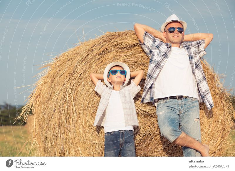 Father and son playing in the park Lifestyle Joy Happy Leisure and hobbies Playing Vacation & Travel Freedom Summer Sun Sports Child Human being Boy (child) Man