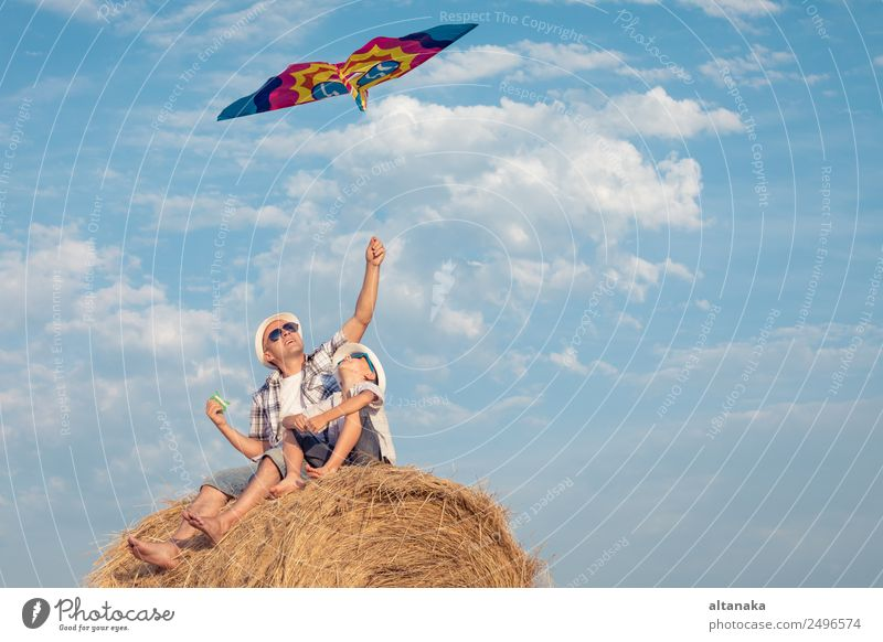 Father and son playing in the park Lifestyle Joy Happy Leisure and hobbies Playing Vacation & Travel Freedom Summer Sports Child Human being Boy (child) Man
