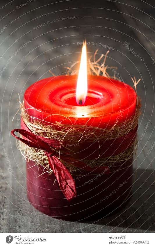 Red candle Christmas & Advent Candle Peaceful Calm Candlelight Light Fire Decoration Holiday season Winter Ornament Wooden table Colour photo Studio shot