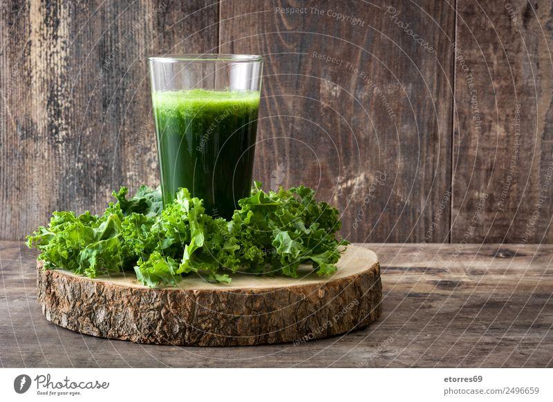 Kale smoothie in glass on wooden background. Milkshake Beverage Drinking Green Detox Healthy Healthy Eating Vitamin superfood Vegan diet Vegetarian diet Diet