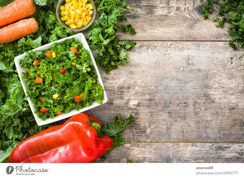 Kale salad and ingredients on wood Healthy Eating Green Red Food photograph Yellow Health care Copy Space Nutrition Vegetable Good Organic produce Bowl Middle