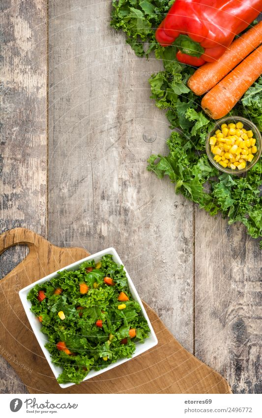 Kale salad and ingredients on wood Healthy Eating Green Red Food photograph Yellow Health care Copy Space Orange Nutrition Vegetable Good Organic produce Bowl