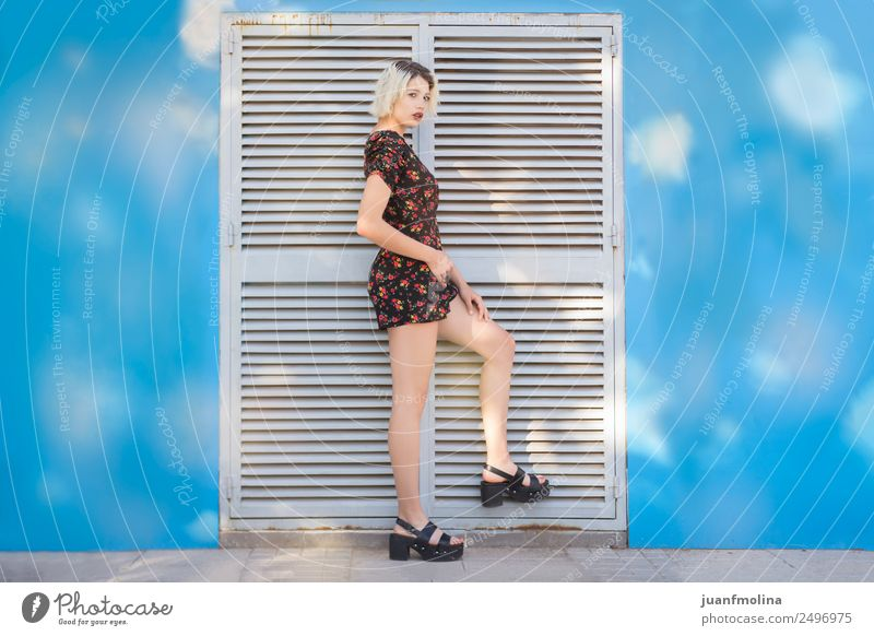 Blonde girl posing on a door Lifestyle Shopping Elegant Style Beautiful Body Feminine 18 - 30 years Youth (Young adults) Adults Music Fashion Clothing Graffiti