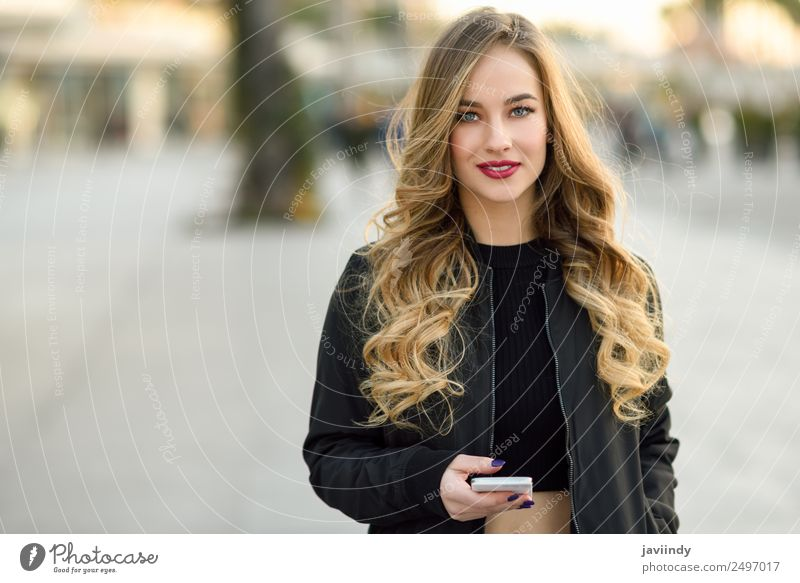 Blonde russian woman in urban background Lifestyle Style Beautiful Hair and hairstyles Telephone Human being Feminine Young woman Youth (Young adults) Woman