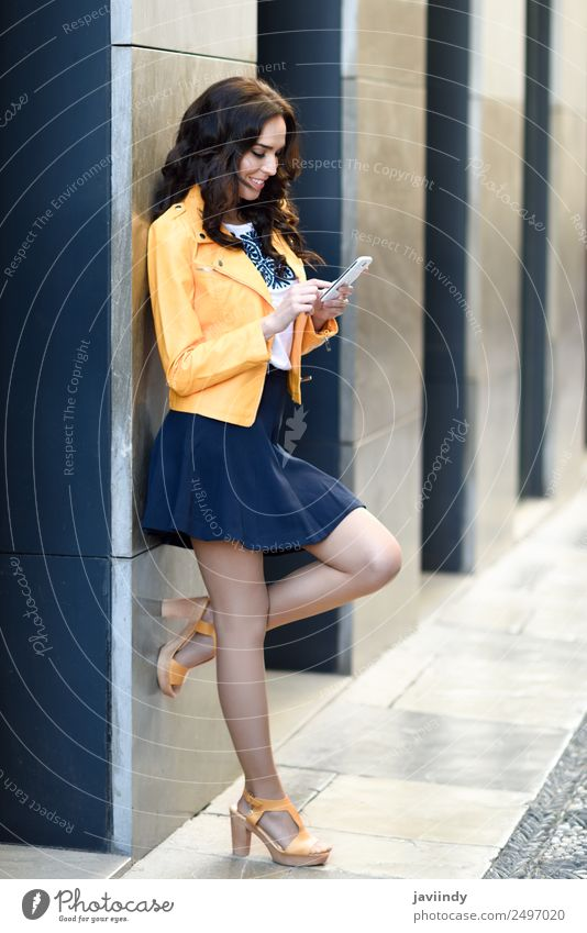 Young woman texting with her smart phone Lifestyle Shopping Style Happy Beautiful Telephone PDA Technology Human being Feminine Youth (Young adults) Woman