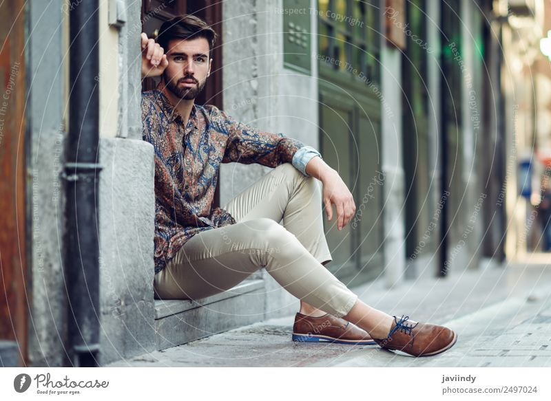 Young bearded man sitting in an urban step Lifestyle Style Beautiful Hair and hairstyles Human being Masculine Young man Youth (Young adults) Man Adults 1