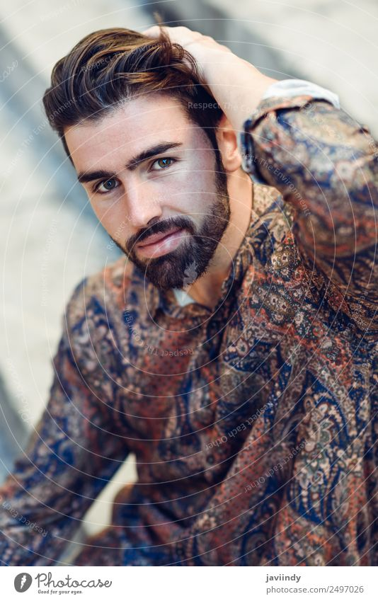 Guy with beard and modern hairstyle in urban background. Lifestyle Style Beautiful Hair and hairstyles Human being Masculine Young man Youth (Young adults) Man