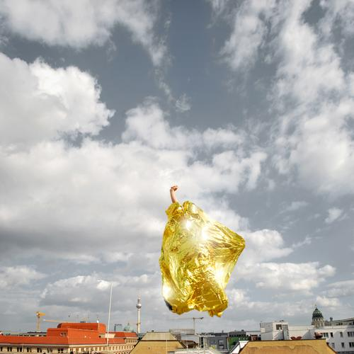 Golden Rider Human being Masculine Life 1 Town Capital city Jump Success Competition Fist Gold foil Skyline Roof Clouds Advice Career Planning Upward Crazy