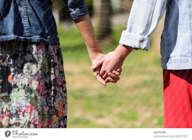 Two young women in walking holding her hands outdoors Lifestyle Joy Happy Beautiful Human being Feminine Young woman Youth (Young adults) Woman Adults