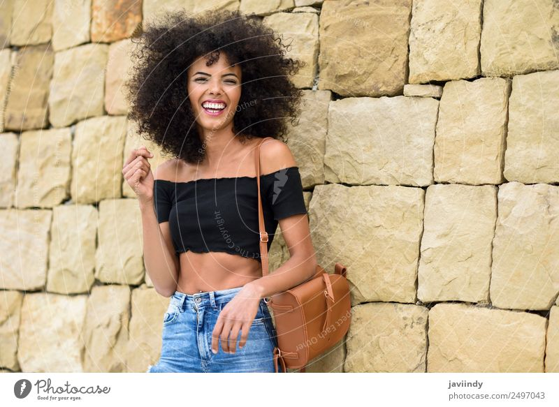Happy mixed woman with afro hair laughing outdoors Lifestyle Style Joy Hair and hairstyles Human being Feminine Young woman Youth (Young adults) Woman Adults 1