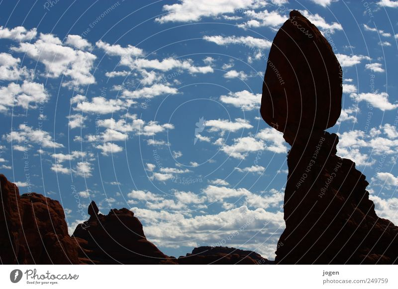 balanced skirt Environment Nature Landscape Elements Earth Sand Air Water Sky Clouds Rock Canyon Arches National Park Rock formation Natural terrace Erosion