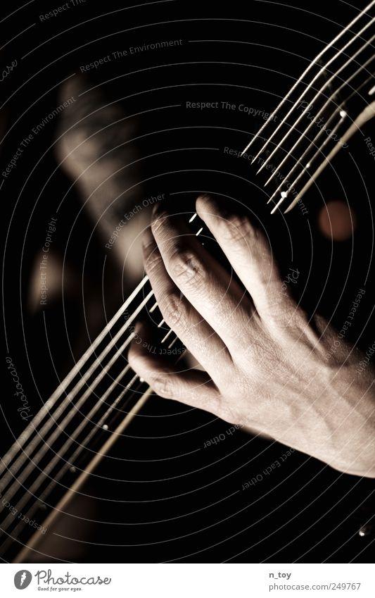 Five strings to luck Masculine Man Adults Hand Fingers 1 Human being Artist Music Concert Band Musician Double bass bassist bass player Rock band Cool (slang)