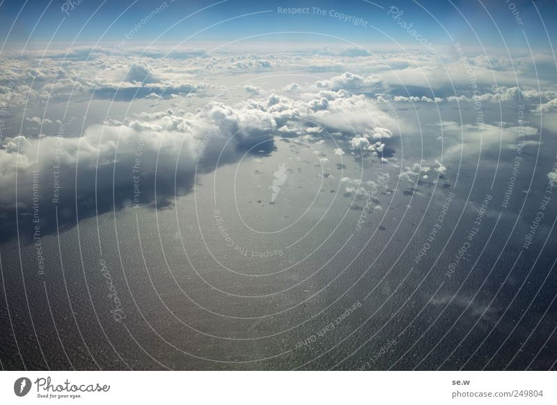 above the clouds Elements Sky Cloudless sky Clouds Summer Weather Beautiful weather Ocean Atlantic Ocean Aviation View from the airplane Flying Looking Gigantic