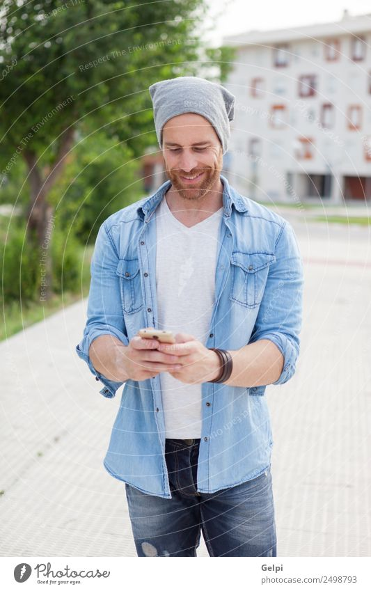Casual guy Lifestyle Style Joy Happy Leisure and hobbies Telephone PDA Technology Human being Man Adults Street Fashion Shirt Hat Beard Listening Smiling Write