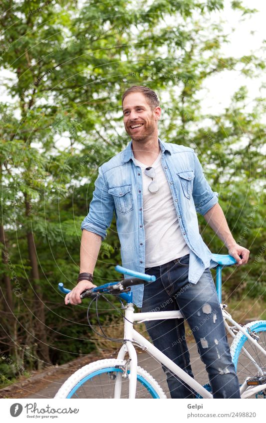 Casual guy Lifestyle Joy Happy Leisure and hobbies Vacation & Travel Summer Sports Cycling Human being Man Adults Nature Park Transport Street To enjoy Smiling
