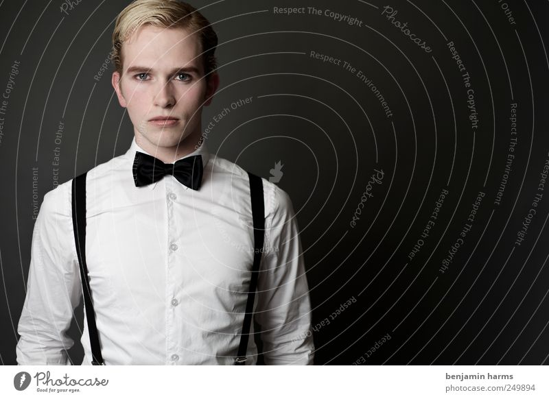 one man Masculine Young man Youth (Young adults) 1 Human being 18 - 30 years Adults Suspenders Bow tie Hair and hairstyles Blonde Short-haired Part Looking