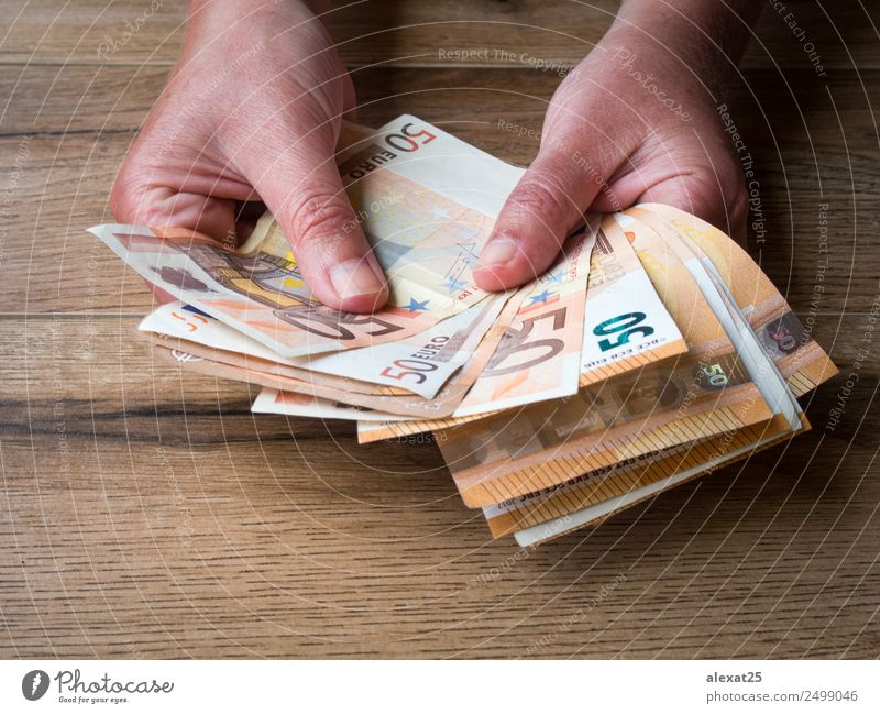 Woman hands with group of fifty euros banknotes Shopping Money Save Success Economy Financial Industry Business Adults Hand Paying Rich White background