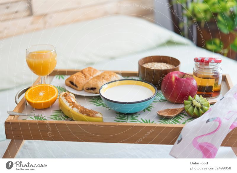 Breakfast in the bed Apple Croissant Eating Beverage Juice Coffee Tea Lifestyle Luxury Relaxation Vacation & Travel Bedroom Woman Adults Couple Wood Authentic