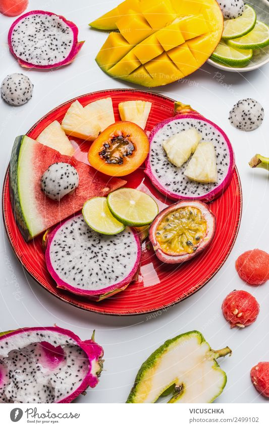 Various tropical fruits on a red plate Food Fruit Dessert Nutrition Breakfast Organic produce Vegetarian diet Diet Plate Style Design Healthy Eating Summer