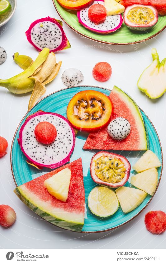 Tropical fruits on blue plate Food Fruit Dessert Style Design Healthy Healthy Eating Life Summer Mango Snack Water melon Pineapple Maracuja Exotic Plate Banana
