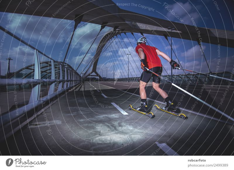 A young man cross-country skiing with roller ski Lifestyle Style Relaxation Summer Sports Man Adults Feet Street Movement Speed Competition Cross-country