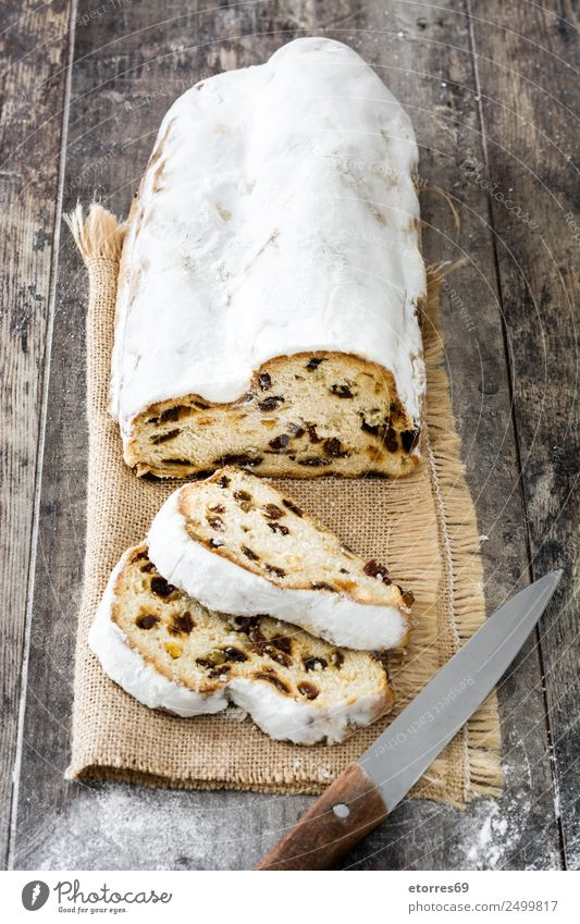 Christmas stollen. Food Fruit Cake Dessert Candy Nutrition Breakfast Lunch Dinner Organic produce Vegetarian diet Knives Christmas & Advent Wood Good Brown