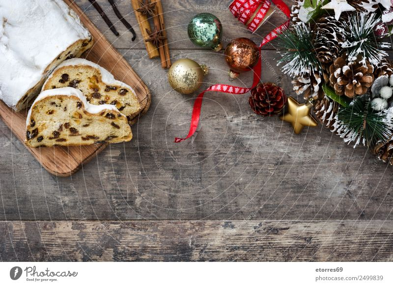 Christmas stollen on wood background Food Fruit Cake Dessert Vacation & Travel Decoration Feasts & Celebrations Christmas & Advent Ball Wood Delicious Sweet