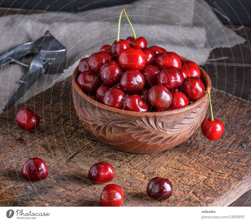 red ripe fresh cherry Fruit Vegetarian diet Bowl Table Nature Wood Eating Fresh Juicy Brown Red Cherry background food healthy sweet Organic Raw Mature Vitamin