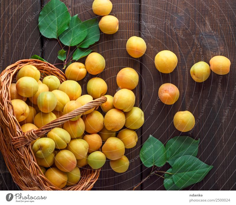 ripe yellow apricots Fruit Nutrition Vegetarian diet Diet Table Nature Leaf Wood Fresh Delicious Natural Juicy Brown Yellow Colour Basket agriculture Apricot
